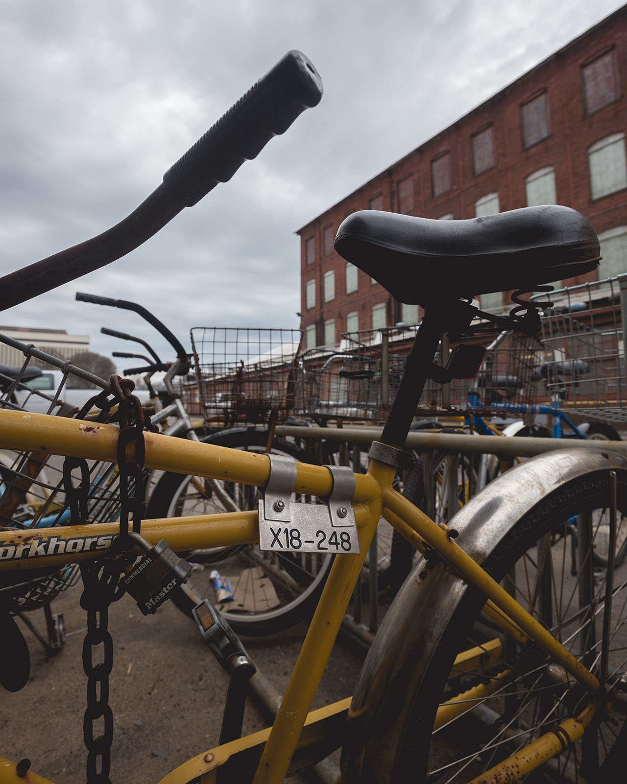 Shipyard bikes wait for their owners as a storm approaches.