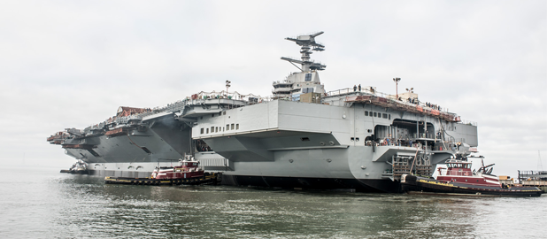 Nov. 17, 2013 - Gerald R. Ford (CVN 78) takes its first journey, leaving the dry dock at Newport News Shipbuilding where it was constructed and moving a mile downriver to complete final outfitting and testing. Photo by Chris Oxley / NNS