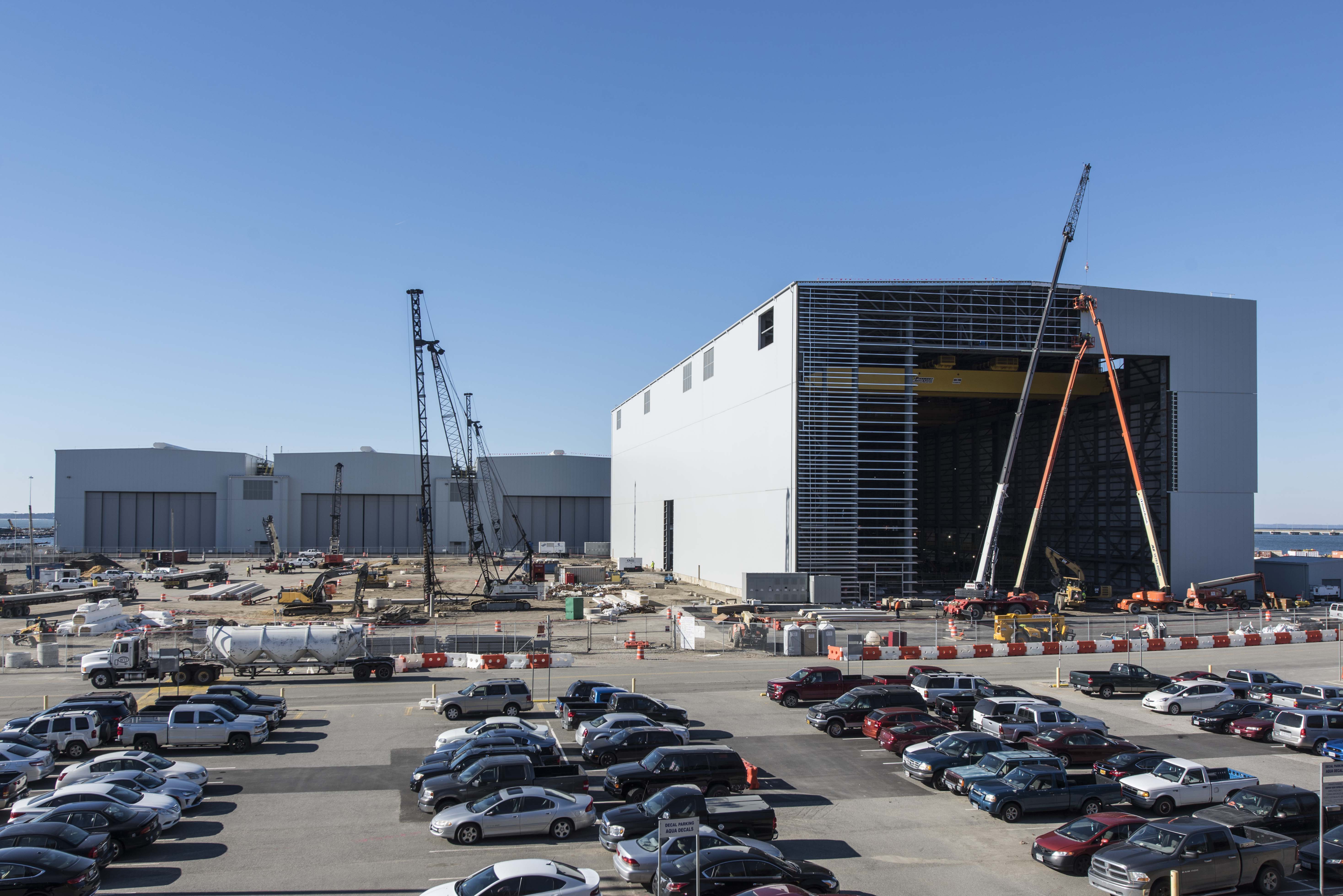 Newport News Shipbuilding's Joint Manufacturing Assembly Facility (JMAF) opened in 2017. The state-of-the-art facility supports submarine and aircraft carrier construction and features multiple worksites, advanced technology, automated equipment, heavyweight cranes, large transportation doors and specialty paint bays.