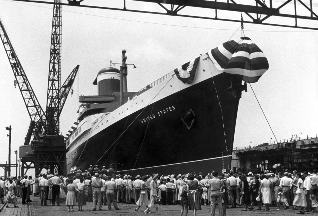"On June 23, 1951, Newport News Shipbuilding christened and launched the luxury passenger liner SS United States. Also known as ""America's Flagship,"" SS United States' superstructure consisted of 23 public rooms, 395 staterooms and 14 first-class suites. She was 100 feet longer than the Titanic and was capable of carrying 2,000 passengers and 1,000 crew members."