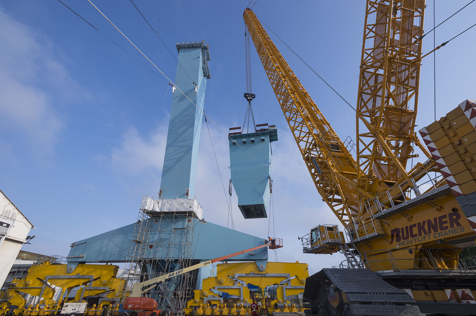 The south leg of Newport News Shipbuilding's new 315-metric-ton Goliath gantry crane is lifted into place.
