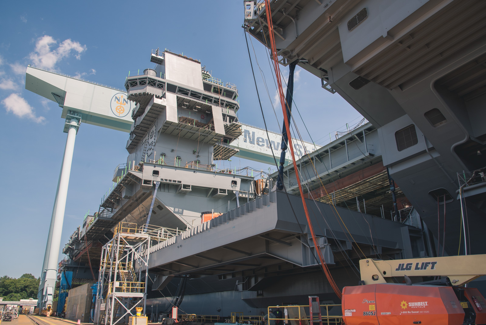 Shipbuilders install an elevator on John F. Kennedy (CVN 79), bringing the ship closer to completion.