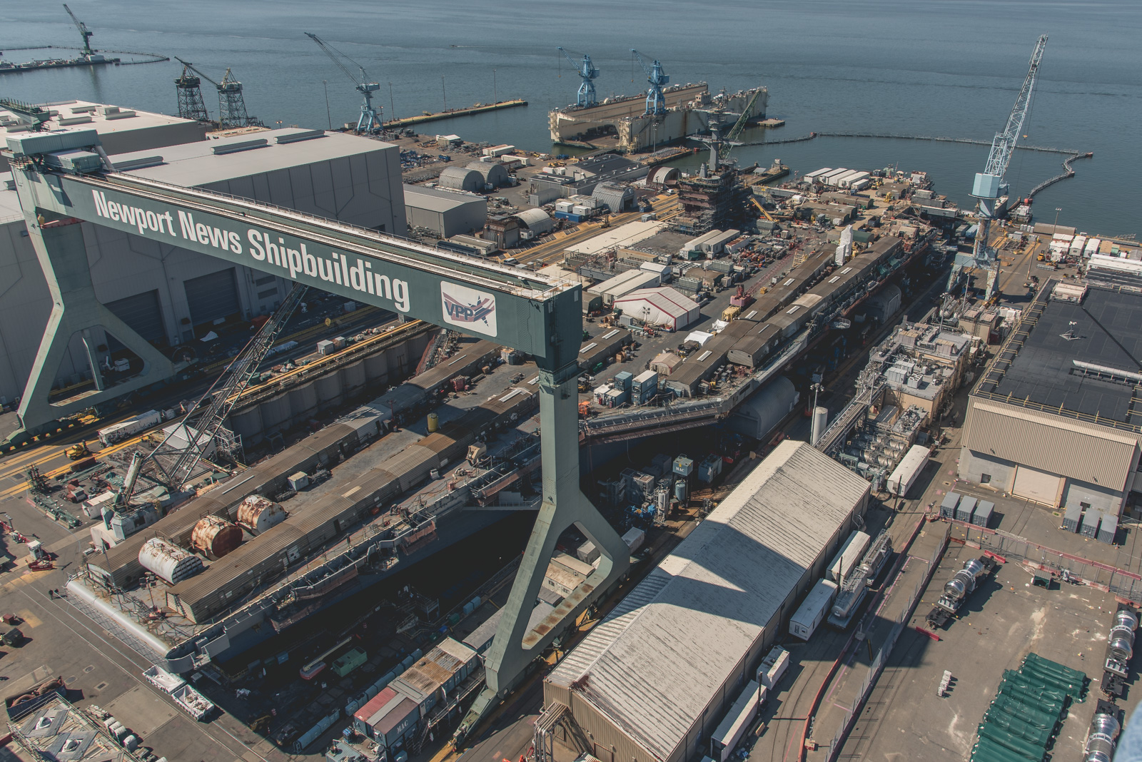 USS George Washington (CVN 73) approaches the end of dry dock work as part of its refueling and complex overhaul. Once the dry dock work is complete, the aircraft carrier will be moved to a nearby outfitting berth for final outfitting and testing.